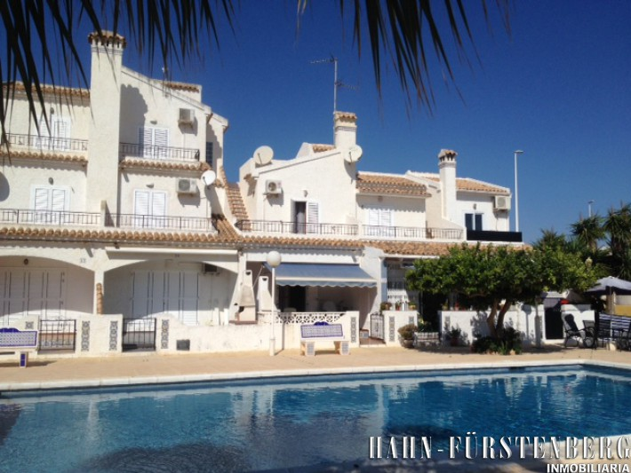 Terraced house overlooking community pool in La Zenia