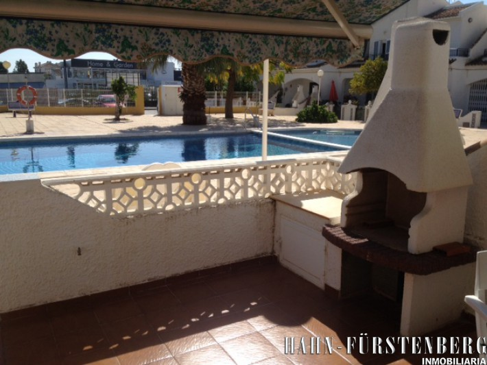 Terraced house overlooking community pool in Cabo Roig